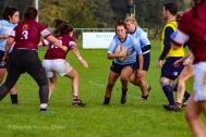 Keely Doonan tucks the ball ready for contact. Photo: Stephen Kisbey-Green