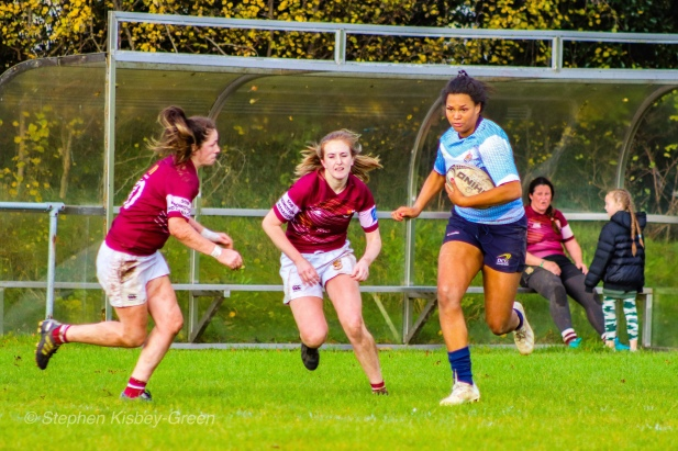 Eimear Corri runs hard at the defence before bursting through for her match-winning hattrick try. Photo: Stephen Kisbey-Green