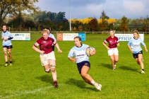 Leah Reilly runs outside the Tullow RFC defence. Photo: Stephen Kisbey-Green