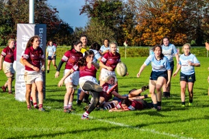 Tullow's scrum half looks to clear the ball off their tryline, after a desperate turnover. Photo: Stephen Kisbey-Green