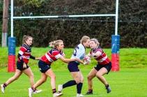 Leah Reilly looks to break the defense against Wicklow RFC. Photo: Stephen Kisbey-Green