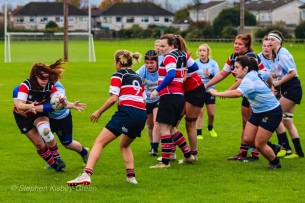 DCU Ladies Rugby Club attempt to shut down Wicklow RFC, while Wicklow get the offload away to their support. Photo: Stephen Kisbey-Green