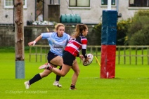 Leah Reilly lines up Wicklow's center for a massive defensive hit. Photo: Stephen Kisbey-Green