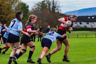 Zoe Valentine puts in a good tackle, preventing a Wicklow breakthrough. Photo: Stephen Kisbey-Green