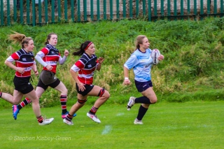 Leah Reilly leads a DCU breakaway, while the Wicklow defense attempt to track her down. Photo: Stephen Kisbey-Green