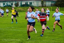 Eimear Corri makes a major carry on the wing on the way to scoring her first try of the day. Photo: Stephen Kisbey-Green