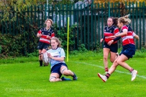 Nikki Gibson bursts up the wing, scoring the try that brought DCU to a lead in the second half. Photo: Stephen Kisbey-Green