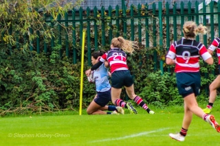 Eimear Corri is tackled on her way to scoring her second try of the match against Wicklow. Photo Stephen Kisbey-Green