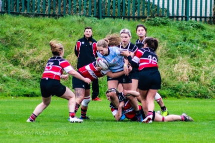 Nikki Gibson attempts to break the Wicklow tackle after making a good steal on her own line. Photo: Stephen Kisbey-Green