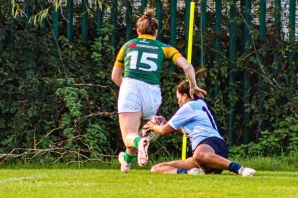 Eimear Corri scores a brilliant try in the corner for DCU against Railway RFC. Photo: Stephen Kisbey-Green
