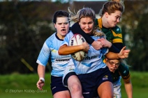 Aine McGroarty is tackled high out wide, while Hannah Heskin looks to appeal for the high tackle. Photo: Stephen Kisbey-Green