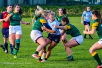 Aine McGroarty is tackled hard by two Railway RFC defenders. Photo: Stephen Kisbey-Green