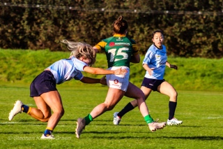 Aine McGroarty puts in the cover tackle on Railway RFC's dangerous fullback. Photo: Stephen Kisbey-Green