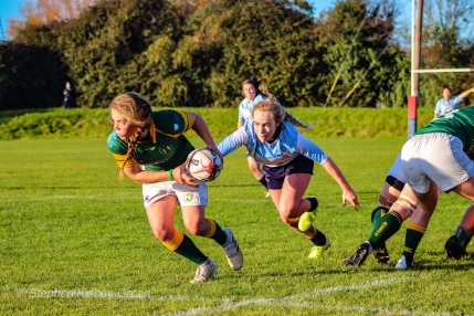 Jane Waters squares up her opposite number before she is able to get the ball out of the back of the scrum. Photo: Stephen Kisbey-Green