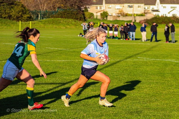 Aine McGroarty beats the defender out wide en route to scoring a try for DCU. Photo Stephen Kisbey-Green