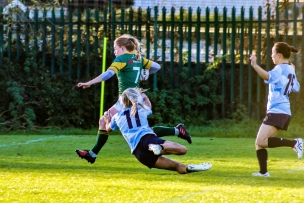 Aine McGroarty tries to reel in the Railway flanker with some good cover defense. Photo: Stephen Kisbey-Green