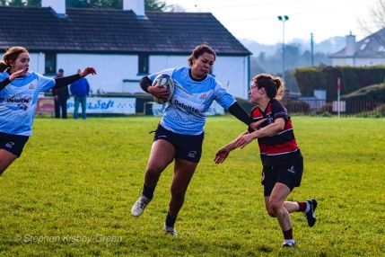 Eimear Corri brushes off a Tullamore tackler as she makes a break up the wing with Louise McCleery in support. Photo: Stephen Kisbey-Green