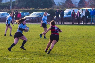 DCU's captain, Hannah Heskin makes a strong run off of their own scrum. Photo: Stephen Kisbey-Green