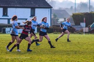 DCU's captain, Hannah Heskin makes a strong run off of their own scrum. Photo: Stephen Kisbey-Green