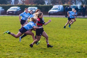 Jane Waters is committed on defense, tracking back to make a strong cover tackle. Photo: Stephen Kisbey-Green