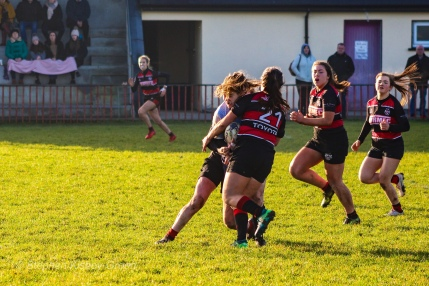 Hannah Heskin is on the receiving end of a massive, high tackle. Photo: Stephen Kisbey-Green