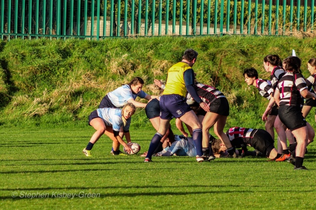 Jane Waters clears the ball from the DCU ruck. Photo: Stephen Kisbey-Green