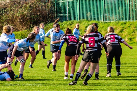 DCU crash the ball into contact. Photo: Stephen Kisbey-Green