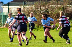 Casey O'Brien looks to spread the ball wide against Old Belvedere RFC. Photo: Stephen Kisbey-Green