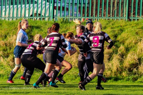 Louise McCleery is surrounded by defenders while trying to make a break up the wing. Photo: Stephen Kisbey-Green