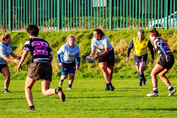DCU attempt to pass the wide against Old Belvedere RFC. Photo: Stephen Kisbey-Green