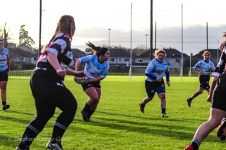 Casey O'Brien swings the ball down the line against Old Belvedere RFC. Photo: Stephen Kisbey-Green