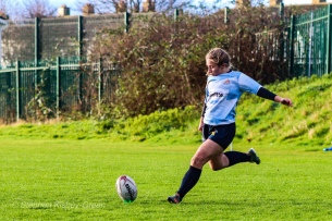 Leah Reilly slots they conversion for DCU. Photo: Stephen Kisbey-Green
