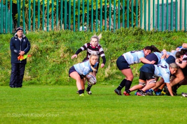 Jane Waters passes the ball out of the back of DCU's scrum. Photo: Stephen Kisbey-Green
