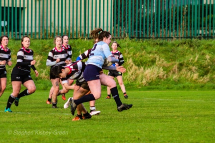 Hannah Heskin bursts through another tackle against Old Belvedere RFC. Photo: Stephen Kisbey-Green