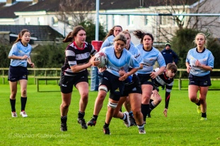 Zoe Valentine tries to break a tackle against Old Belvedere RFC. Photo: Stephen Kisbey-Green