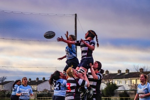 Zoe Valentine competes at the line out for DCU. Photo: Stephen Kisbey-Green