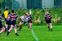 Louise McCleery attempts to spin out a tackle against Old Belvedere RFC. Photo: Stephen Kisbey-Green