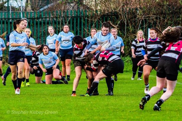 Hannah Heskin draws in two defenders against Old Belvedere RFC. Photo: Stephen Kisbey-Green