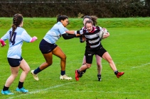 Eimear Corri drags down Old Belvedere RFC's out wide. Photo: Stephen Kisbey-Green