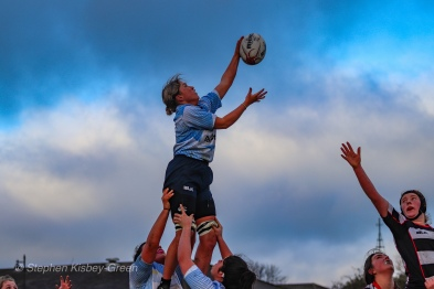 Zoe Valentine competes at the lineout for DCU. Photo: Stephen Kisbey-Green