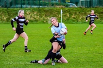 Leah Reilly offloads the ball in the tackle against Old Belvedere RFC. Photo: Stephen Kisbey-Green