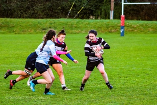 DCU look to close out Old Belvedere RFC on the wing. Photo: Stephen Kisbey-Green