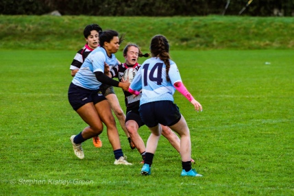 Eimear Corri wraps up Old Belvedere RFC's winger. Photo: Stephen Kisbey-Green