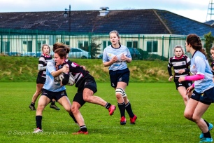 DCU tackling Old Belvedere RFC in the centers. Photom Stephen Kisbey-Green
