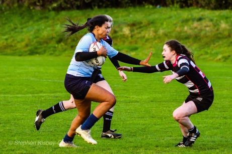 Eimear Corri looks to hand off an Old Belvedere RFC defender. Photo: Stephen Kisbey-Green