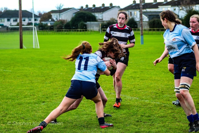 Louise McCleery putting in a big hit on defense. Photo: Stephen Kisbey-Green