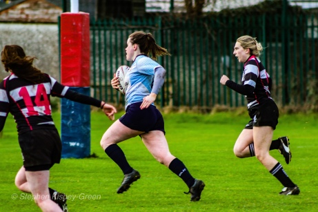 Hannah Heskin on her way to score one of DCU' 7 tries against Old Belvedere RFC. Photo: Stephen Kisbey-Green