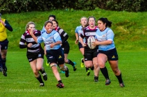 Casey O'Brien on a break against Old Belvedere RFC, with Zoe Valentine in support. Photo: Stephen Kisbey-Green