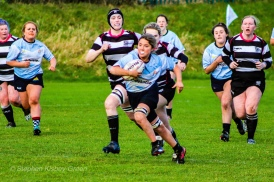 Zoe Valentine breaks through the Old Belvedere RFC defense. Photo: Stephen Kisbey-Green