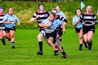 Zoe Valentine breaks through the Old Belvedere RFC defense. Photo: Stephen Kisbey-Green